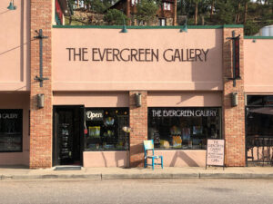 This is a photo of the Evergreen Gallery storefront with the signage and windows.
